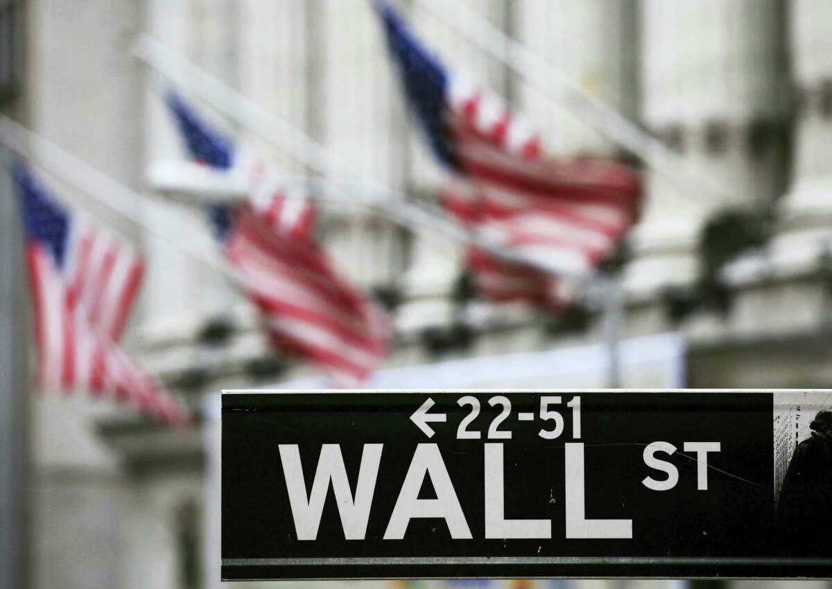 FILE - This April 22, 2010, file photo, shows a Wall Street sign in front of the New York Stock Exchange. Global shares rose Monday, July 11, 2016, after Wall Street rose on a strong U.S. employment report and as investors recovered gradually from post-Brexit jitters.
