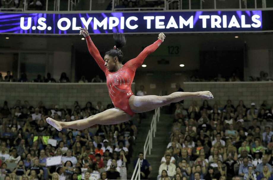 Simone Biles competes on the balance beam during the women's U.S. Olympic gymnastics trials in San Jose on Sunday. Photo: Gregory Bull — The Associated Press    / AP