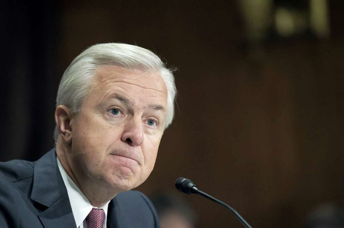 In this Sept. 20, 2016 photo, Wells Fargo CEO John Stumpf testifies on Capitol Hill in Washington, before the Senate Banking Committee. Wells Fargo's embattled CEO Stumpf is out effective immediately, with President and Chief Operating Officer Tim Sloan taking over as the head of the one of the nation's largest banks, the company announced on Oct. 12, 2016.