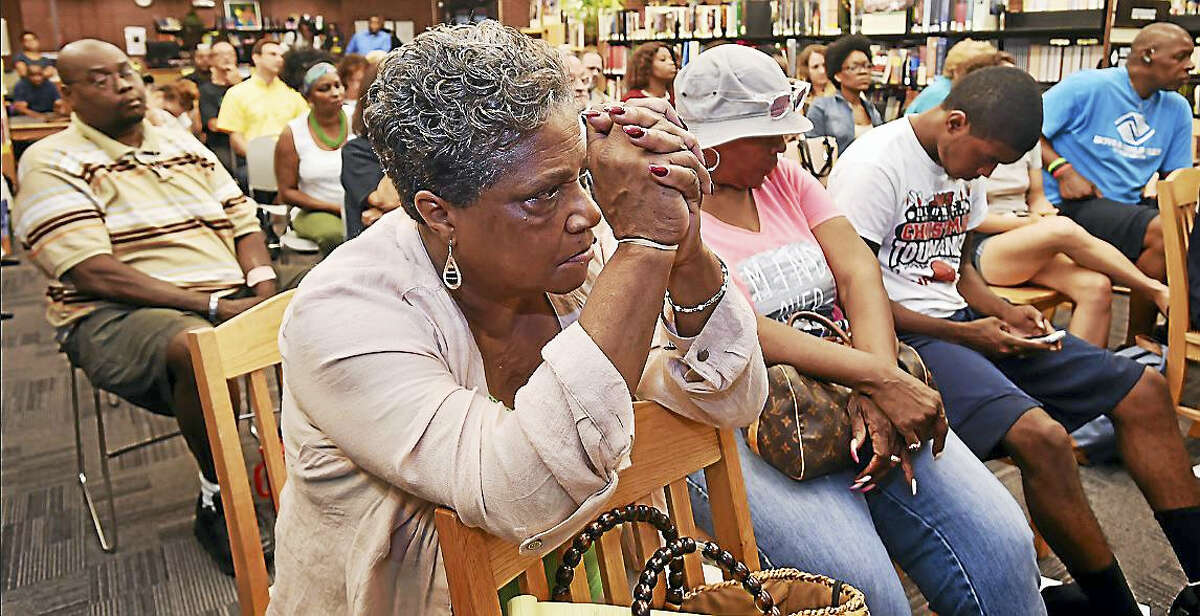 Members of the community came together for a town meeting Wednesday to discuss the performance of New Haven Police Chief Dean Esserman at the Stetson Street Library on Dixwell Avenue in New Haven.