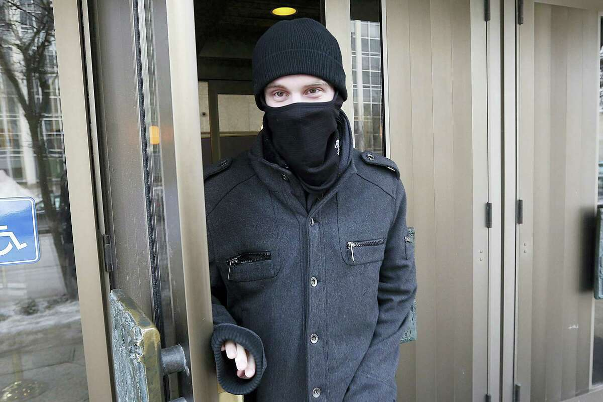 In this Feb. 2, 2016 photo, Aaron Driver leaves the Law Courts in Winnipeg, Manitoba.