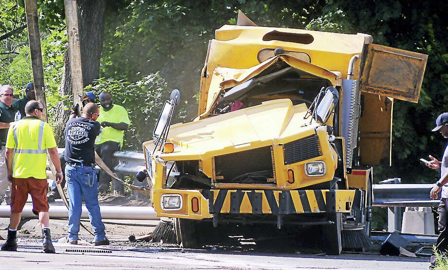 The driver of a street sweeper was killed Thursday after his truck crashed on the Exit 6 ramp from Interstate 91 south. Photo: Wes Duplantier — New Haven Register
