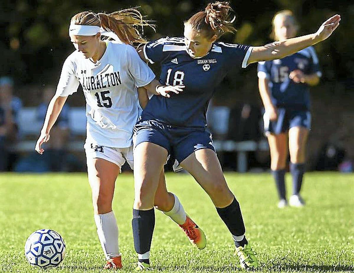 Lauralton Hall senior Mia Mulin battles Lyman Hall senior defender Alexa Eves in a 6-1 win Tuesday for the Crusaders in Milford.