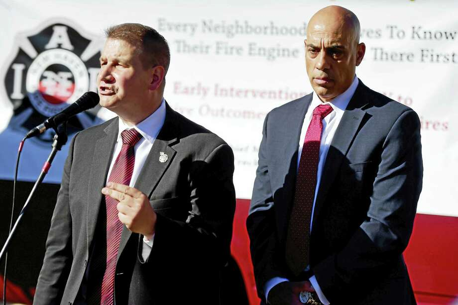 New Haven Fire Department Battalion Chief Frank Ricci, left, with Engine 9 Battalion Chief Mark Vendetto, shares his concerns about the proposed changes to the Ellsworth Avenue firehouse during a rally there Monday in New Haven. Photo: Peter Hvizdak - New Haven Register   / ©2016 Peter Hvizdak