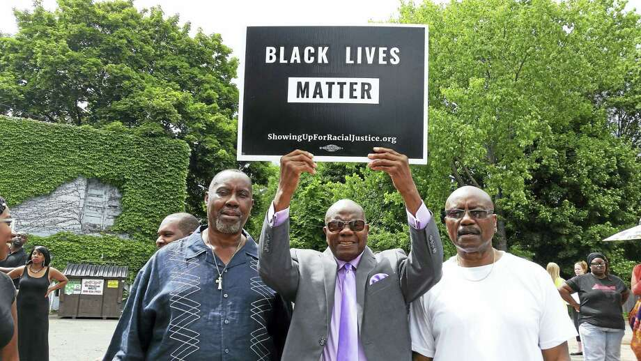 Brothers Jerome, Howard and Jimmy Morrison stand together at the Stand Together Rally Sunday at Varick Memorial AME Zion Church. Photo: Helen Bennett - New Haven Register