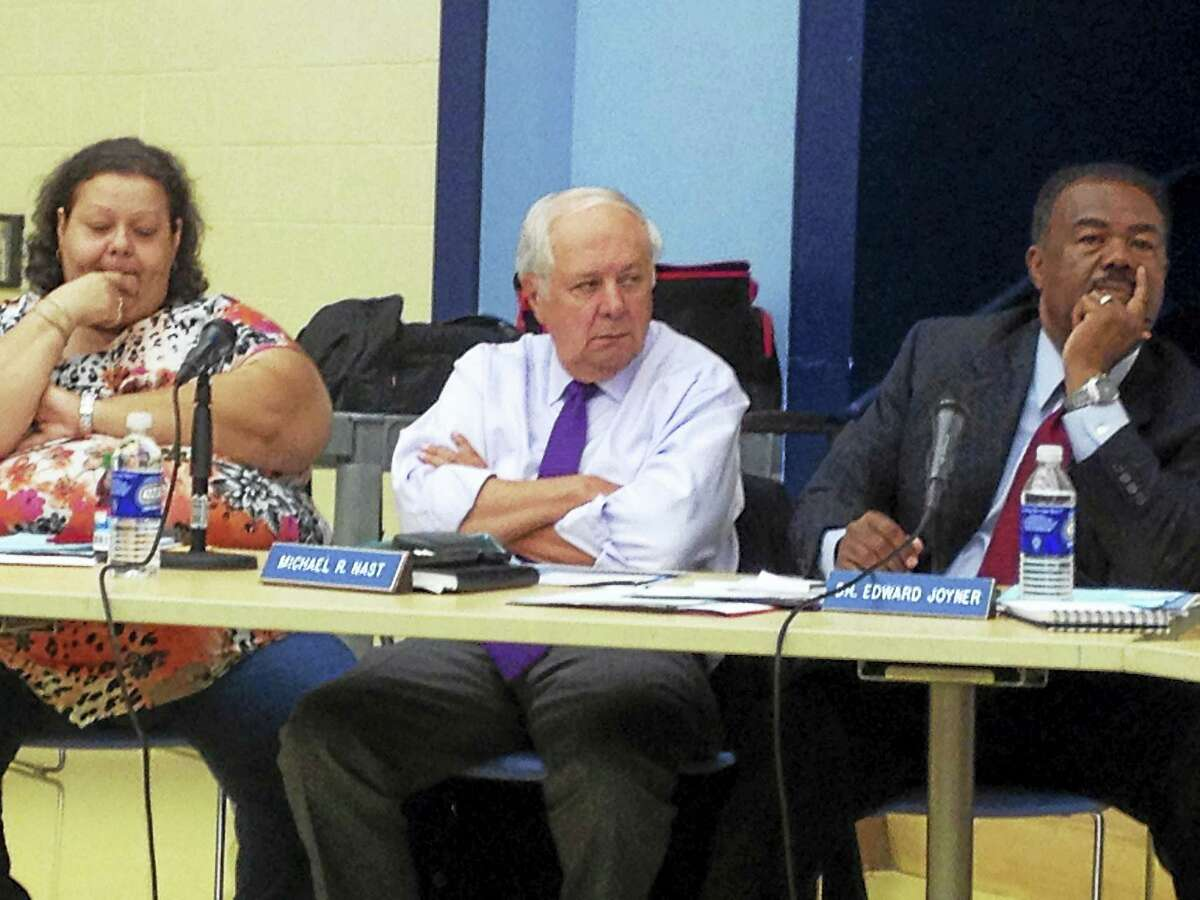 From left, New Haven Board of Education members Daisy Gonzalez, Mike Nast and Edward Joyner.
