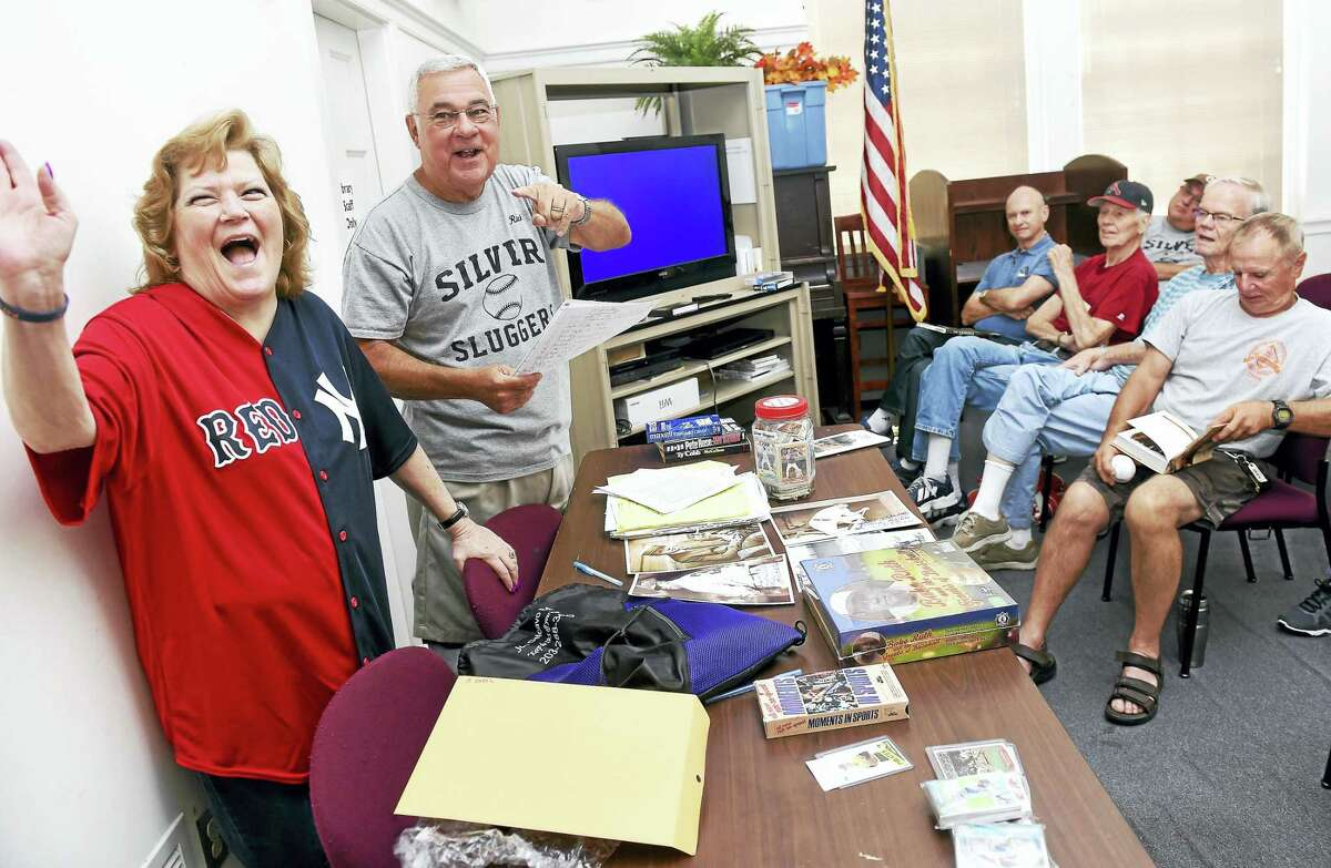 Babe Ruth's granddaughter, Linda Ruth Tosetti, speaks at a meeting of the Silver Sluggers at the Derby Public Library Thursday. At center is Rich Marazzi, coordinator of the Silver Sluggers.