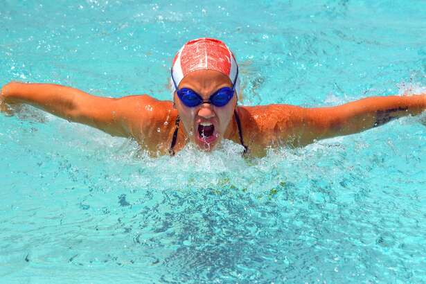 Izzy O'Day of Sunset Hills competes in the girls' 11-12 100-meter individual medley during Sunday's SWISA Championships at Paddlers Swim Club in Granite City.