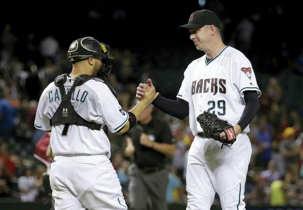 Arizona Diamondbacks closer Brad Ziegler, right, was traded to the Red Sox early Saturday.