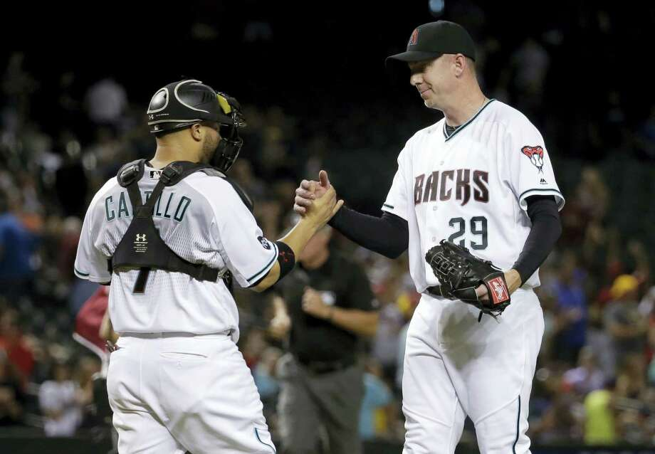 Arizona Diamondbacks closer Brad Ziegler, right, was traded to the Red Sox early Saturday. Photo: The Associated Press File Photo   / AP