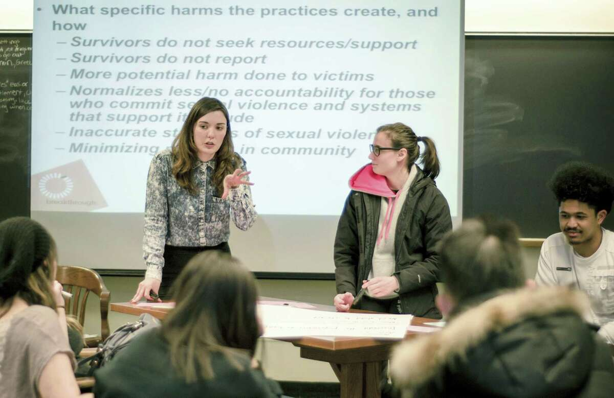 "In this April 8, 2016 photo provided by Breakthrough, Columbia University graduate student Savannah Badalich leads a Breakthrough Campus Catalyst Training with student activists at Syracuse University in Syracuse, N.Y., for Sexual Assault Awareness Month. When news broke that Donald Trump, the Republican nominee for president, had bragged of groping women, and then trivialized it as ""locker room talk,"" it felt to some students like a repudiation of their efforts."