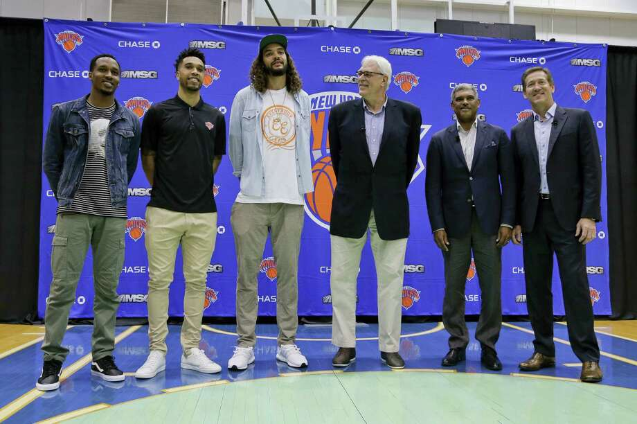 From left, Brandon Jennings, Courtney Lee, Joakim Noah, president Phil Jackson, general manager Steve Mills and head coach Jeff Hornacek pose for photos after a news conference on Friday. Photo: Julie Jacobson — The Associated Press   / Copyright 2016 The Associated Press. All rights reserved. This material may not be published, broadcast, rewritten or redistribu