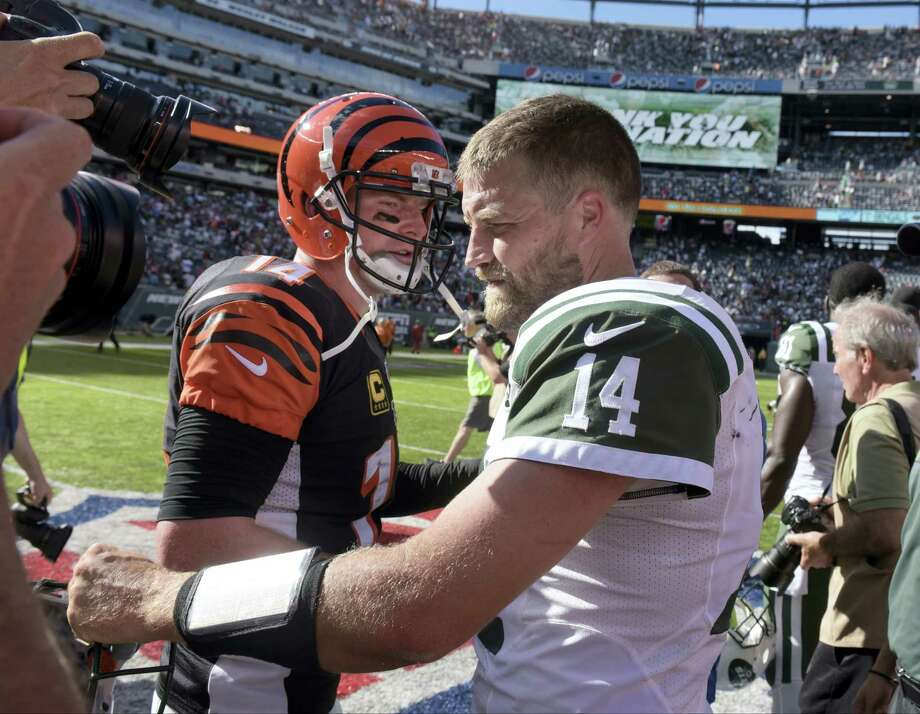 Jets quarterback Ryan Fitzpatrick, right, and Bengals quarterback Andy Dalton meet after Sunday's game. Photo: Bill Kostroun — The Associated Press   / Copyright 2016 The Associated Press. All rights reserved.