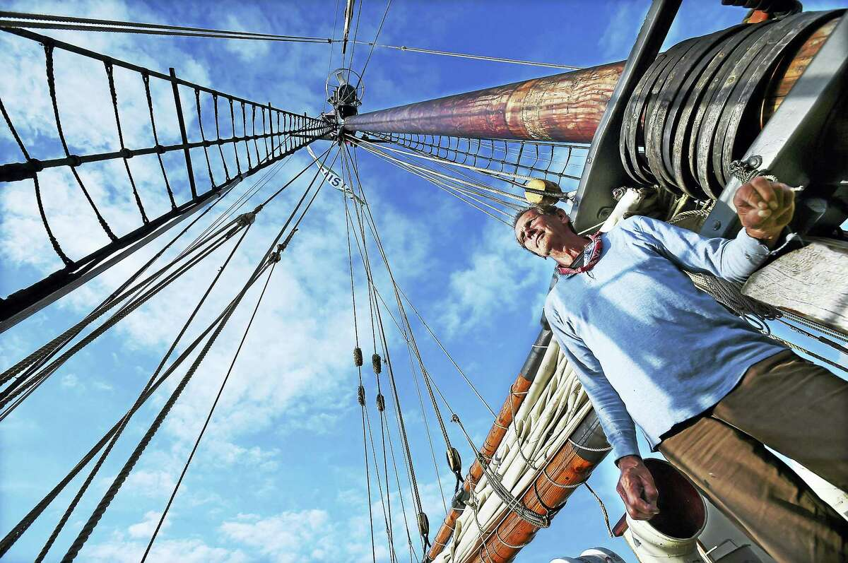 Evan, a senior deck hand who lives full-time on the Freedom Schooner Amistad, is seen beneath the hundred-foot mast, was back in the vessel's homeport at Long Wharf Pier in New Haven Wednesday. He would not provide his last name.