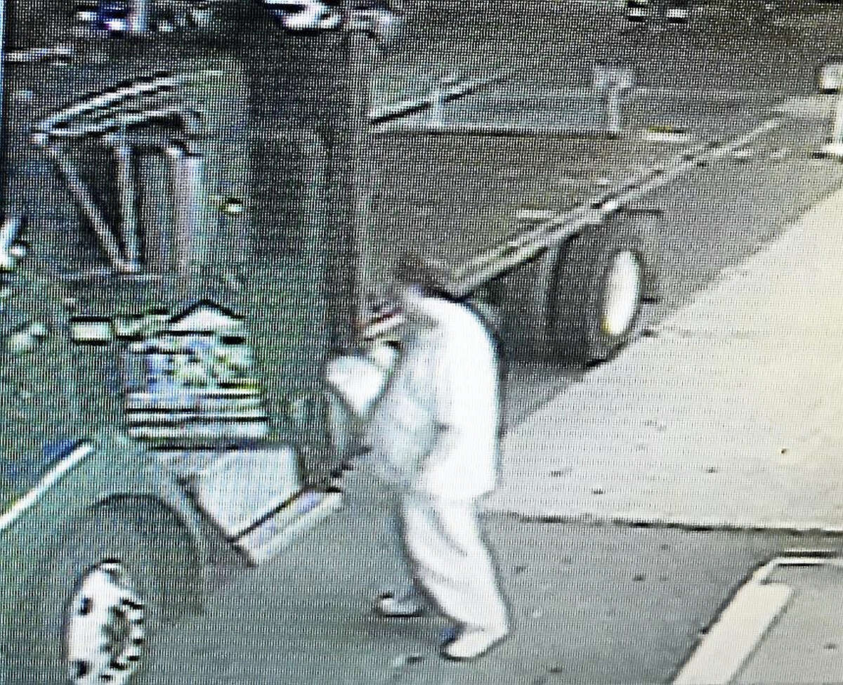 Suspect approaches truck believed to have been used in burglaries.