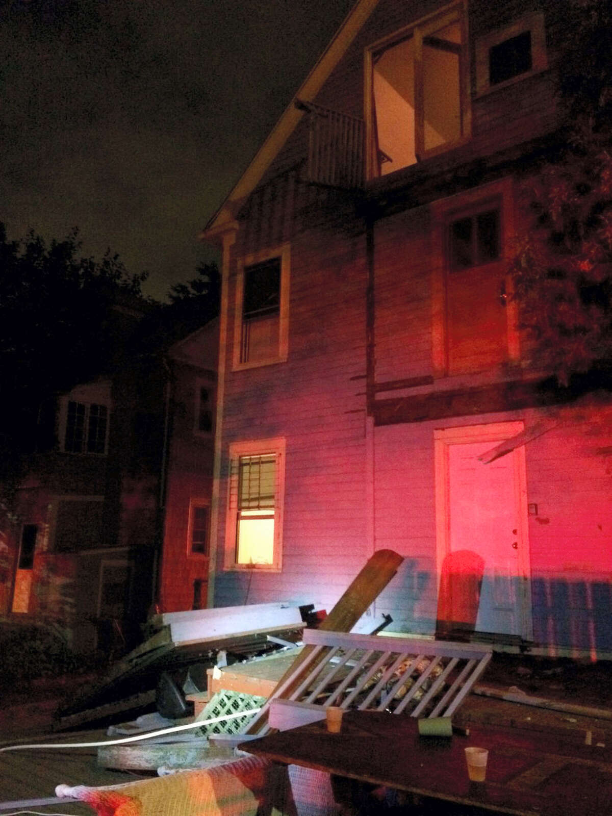 This photo provided by the Hartford Police Department shows a collapsed deck at a house near Trinity College in Hartford, Conn. on Sept. 10, 2016. Deputy Chief Brian Foley of the Hartford police posted on his Twitter feed that a third-floor deck of a house about two-tenths of a mile from the Trinity campus collapsed onto a second-floor deck, which subsequently fell onto a first-floor deck.