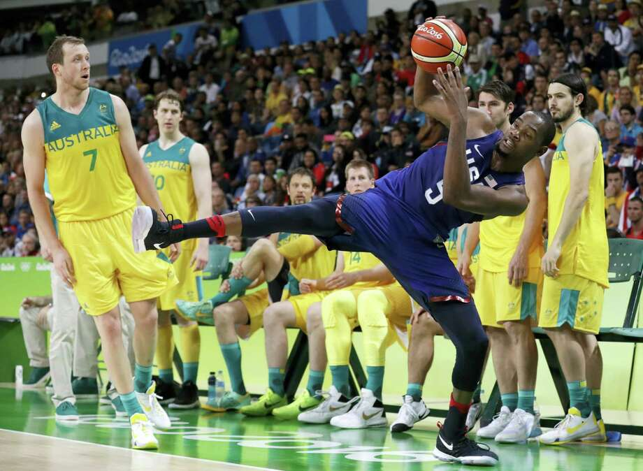 United States' Kevin Durant is fouled by Australia's Joe Ingles during the 98-88 U.S. victory at the 2016 Summer Olympics in Rio de Janeiro, Brazil, Wednesday. Photo: CHARLIE NEIBERGALL — THE ASSOCIATED PRESS   / Copyright 2016 The Associated Press. All rights reserved. This material may not be published, broadcast, rewritten or redistribu