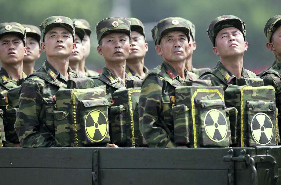 In this July 27, 2013, file photo, North Korean soldiers turn and look towards their leader Kim Jong Un from a military parade vehicle as they carry packs marked with the nuclear symbol during a ceremony marking the 60th anniversary of the Korean War armistice in Pyongyang, North Korea. Mark up another first for North Korea - two nuclear tests in one year. Photo: The Associated Press   / Copyright 2016 The Associated Press. All rights reserved.