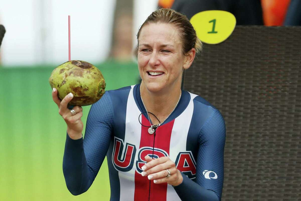 Cyclist Kristin Armstrong of the United States holds a coconut after wining the women's individual time trial event at the 2016 Summer Olympics in Pontal beach, Rio de Janeiro, Brazil on Aug. 10, 2016.