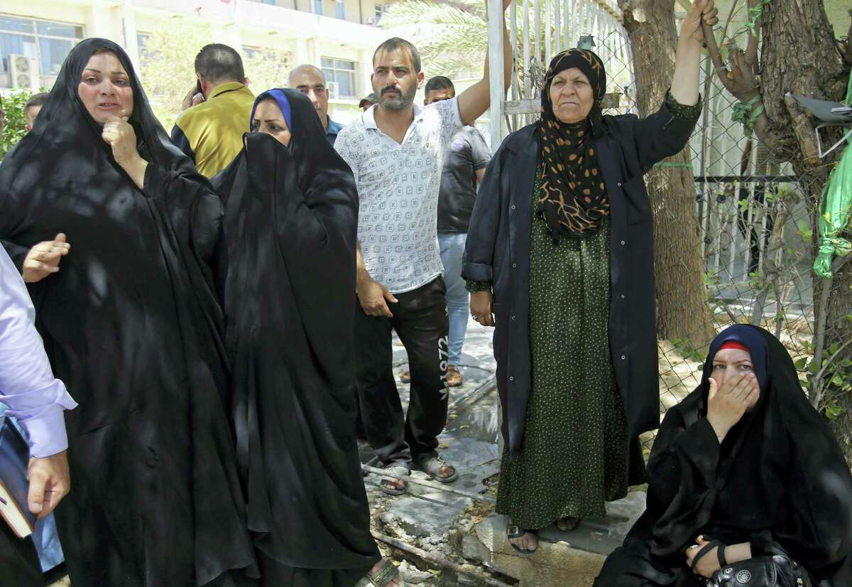 Families of newborn babies who died in a fire gather outside a maternity ward at Yarmouk hospital in western Baghdad, Iraq, Wednesday, Aug. 10, 2016. A fire ripped through the maternity ward at the Baghdad hospital overnight, killing at least 11 newborn babies in a deadly blaze that was likely caused by faulty electrical wiring, an Iraqi spokesman said Wednesday.