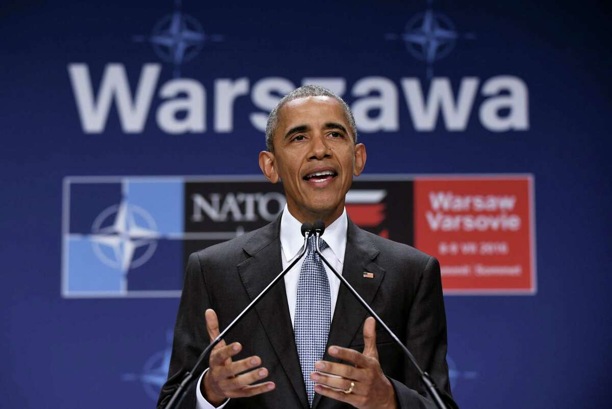 President Barack Obama speaks about the events in Dallas at the beginning of his news conference at PGE National Stadium in Warsaw, Poland, Saturday, July 9, 2016.