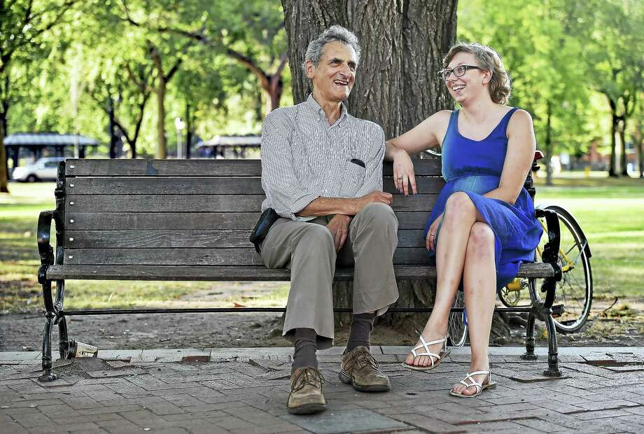 Henry Auer and Sarah Ganong discuss plans for the newly formed Environmental Advisory Council in New Haven, Thursday, September 8, 2016, on the New Haven Green at the corner of Chapel and Church Street. Photo: Catherine Avalone/New Haven Register    / New Haven RegisterThe Middletown Press
