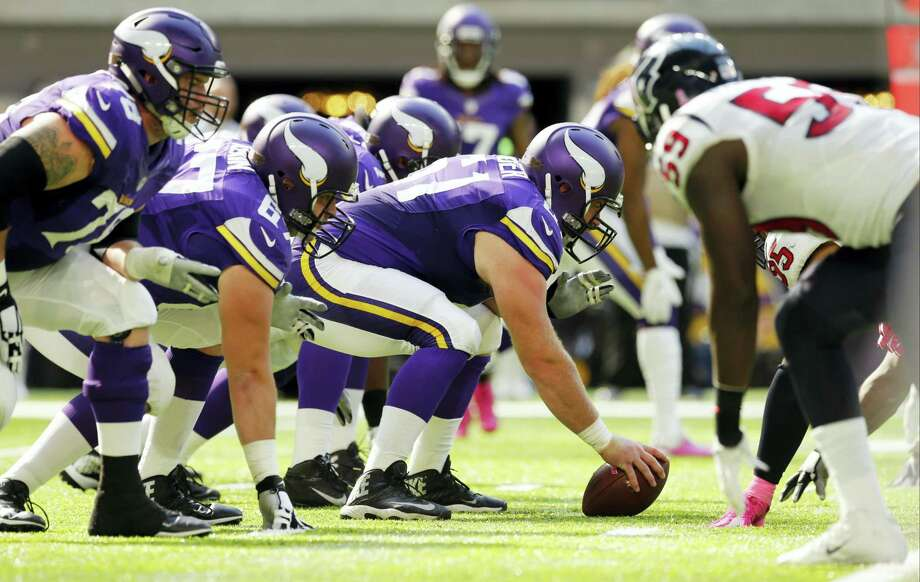 Players get set on the line of scrimmage during the first half of an NFL football game between the Minnesota Vikings and the Houston Texans on Oct. 9, 2016 in Minneapolis. Photo: AP Photo/Jim Mone   / AP
