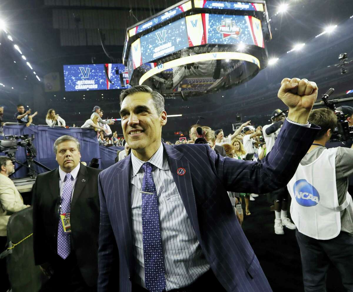 In this April 4, 2016 photo, Villanova head coach Jay Wright celebrates after the NCAA Final Four tournament college basketball championship game against North Carolina, in Houston. Defending national champion Villanova is the runaway preseason No. 1 in the Big East Conference.
