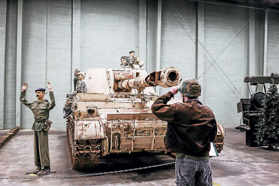 Wearing a helmet, William Durham, 15, gets up close to several tanks at the American Amoured Foundation Tank Museum. A $5 raffle ticket buys you the chance to ride inside a M901 missile-carrying armored vehicle. Photo: Greg Kahn For The Washington Post / For The Washington Post