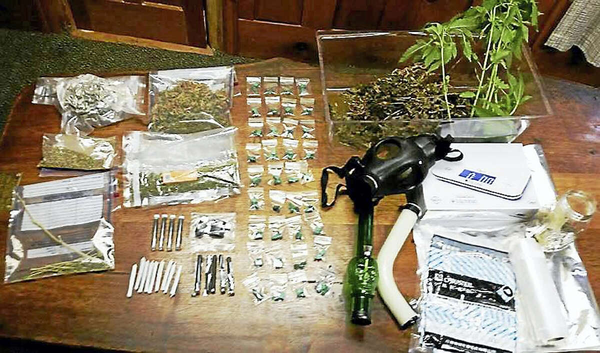 Connecticut EnCon police say marijuana and drug paraphernalia were seized from an apartment in a home in New Hartford. They also allegedly found a 2-foot American alligator there.