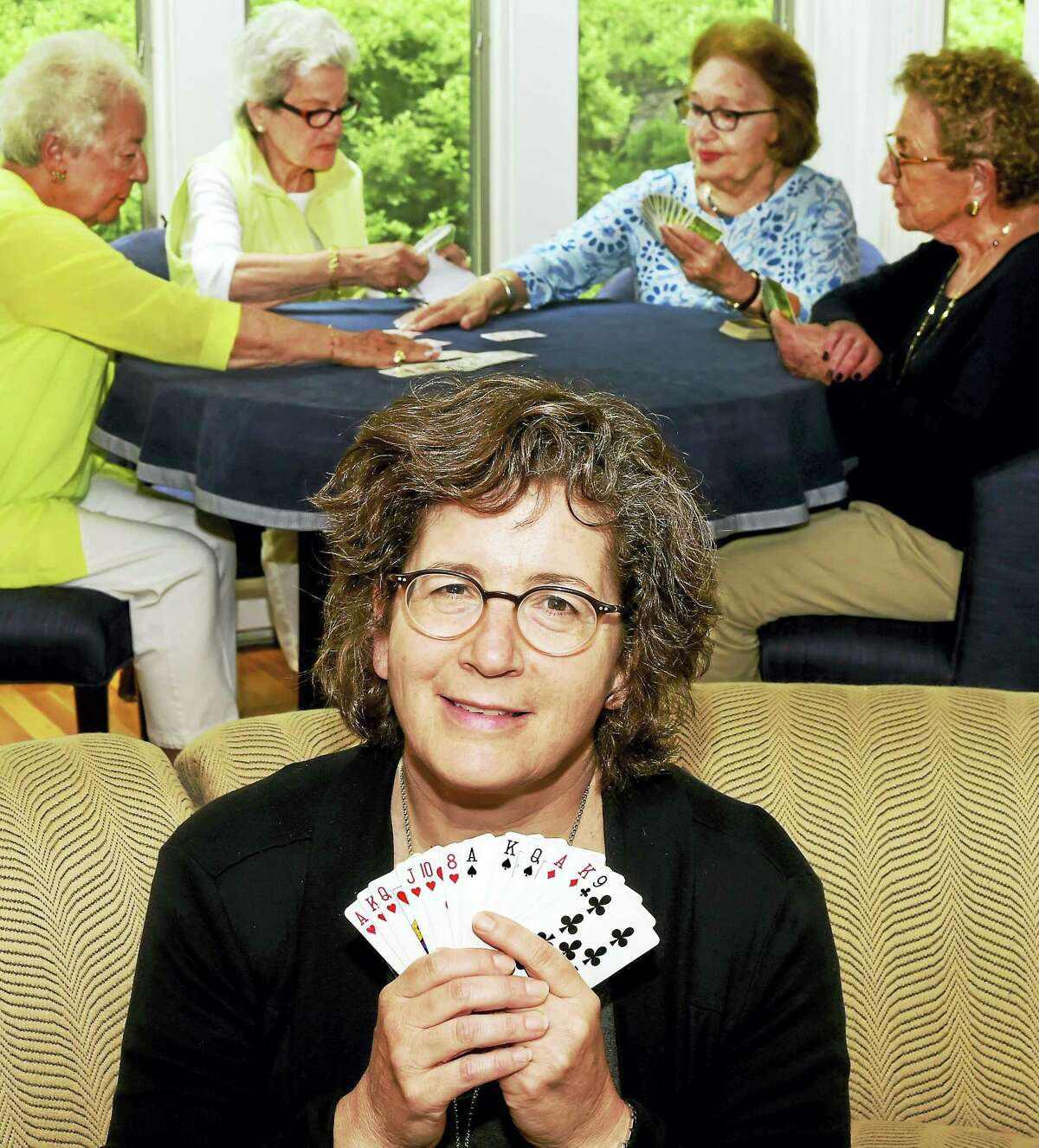 Betsy Lerner, foreground, author the book The Bridge Ladies, who has written a book about a group of ladies who have been playing Bridge together for about 50 years. In background, left to right, are Rhoda Myers of Milford, Bette Horowitz of Woodbridge, Jackie Podoloff of Bethany, and Roslyn Lerner of Woodbridge.
