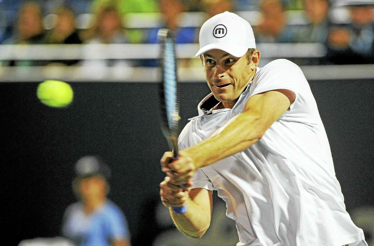 Andy Roddick hits a backhand during his Legends match against James Blake in 2014 in New Haven.