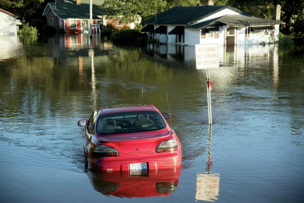 A car is submerged in floodwaters caused by rain from Hurricane Matthew in Lumberton, N.C., Monday, Oct. 10, 2016.