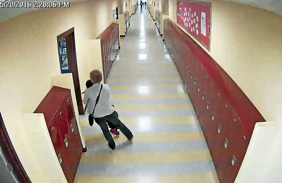 Screengrab of surveillance video allegedly showing Karen Lorde and a student at Roberto Clemente Leadership Academy. Photo: Courtesy Of New Haven School District