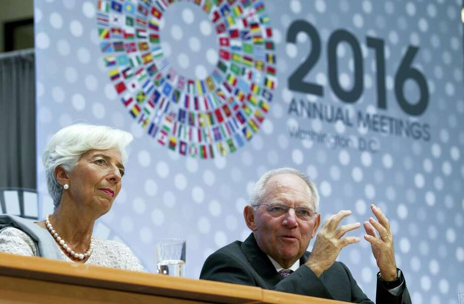International Monetary Fund Managing Director Christine Lagarde, left, and Germany's Finance Minister Wolfgang Schauble speak at CNN Debate on the Global Economy during World Bank/IMF Annual Meetings at IMF headquarters in Washington Thursday. Photo: AP Photo — Jose Luis Magana   / FR159526 AP