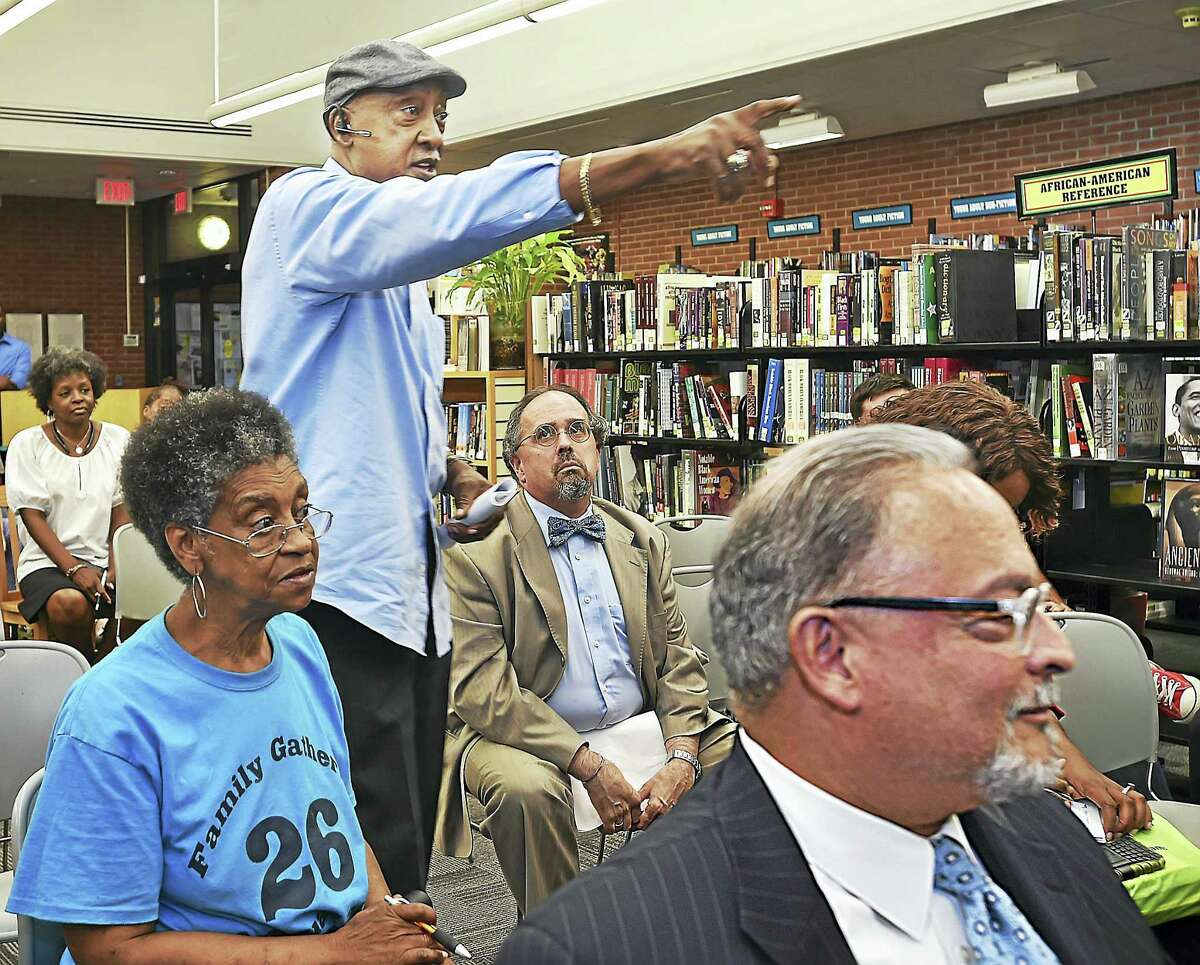 Retired New Haven police Officer Odell Cohens speaks to members of the community at a meeting Wednesday, the focus of which was police Chief Dean Esserman, at the Stetson Branch Library in New Haven.
