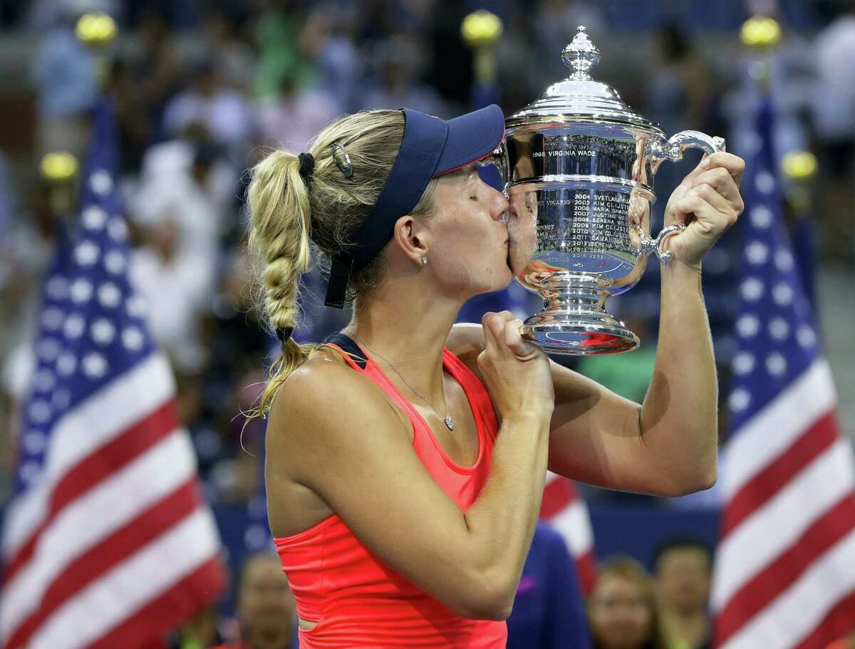 Angelique Kerber kisses the championship trophy after beating Karolina Pliskova in the women's final at the U.S. Open on Saturday.