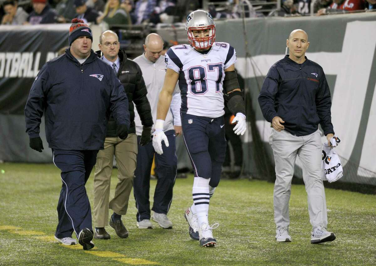 FILE - In this Nov. 27, 2016, file photo, New England Patriots tight end Rob Gronkowski (87) walks off the field with an injury during the second quarter of an NFL football game against the New York Jets,in East Rutherford, N.J. Gronkowski is having surgery for a herniated disk in his back, a person with knowledge of the details tells The Associated Press. The person spoke Thursday, Dec. 1, 2016, on condition of anonymity because the surgery has not yet been announced by the team. The surgery was first reported by the Buffalo News.(AP Photo/Bill Kostroun, File)