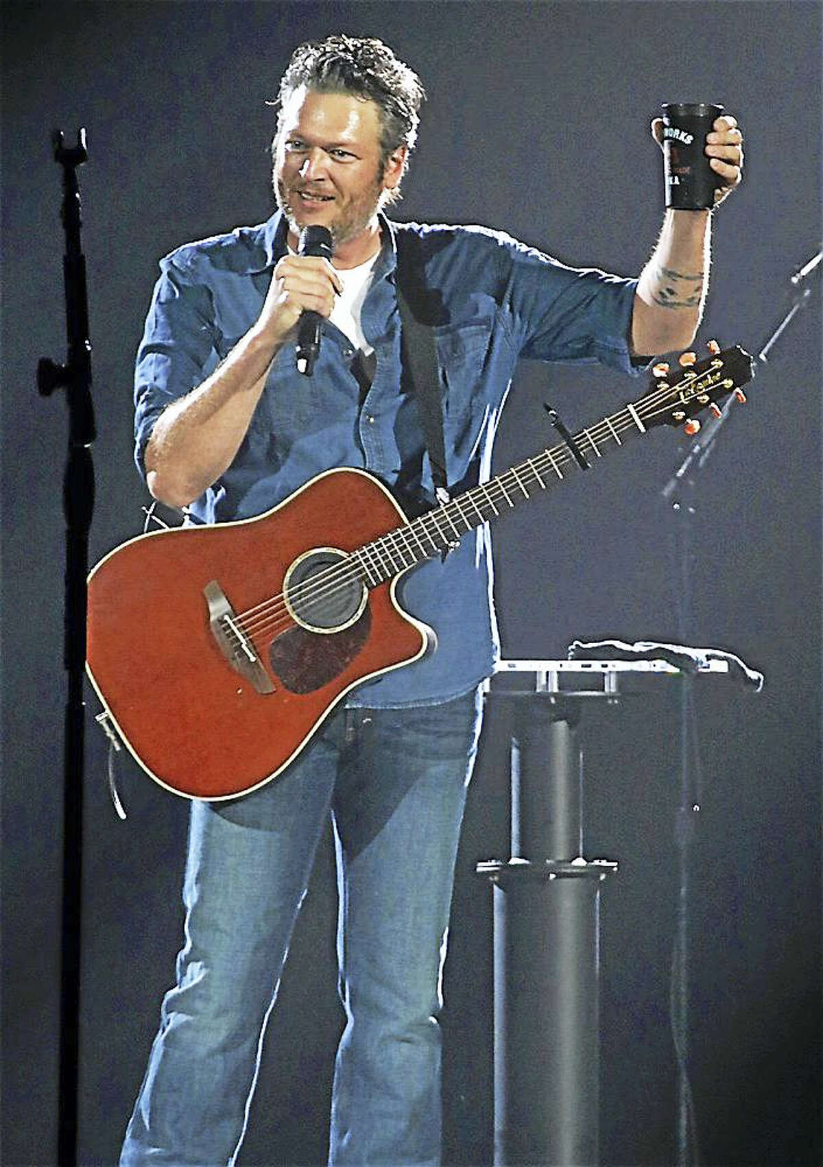"""Photo by John AtashianCountry music singer, songwriter, and television personality Blake Shelton is shown toasting his fans at the XL Center at the start of his concert on Sept. 30. Blake is currently on a U.S. tour in support of his tenth album, """"If I'm Honest""""."""