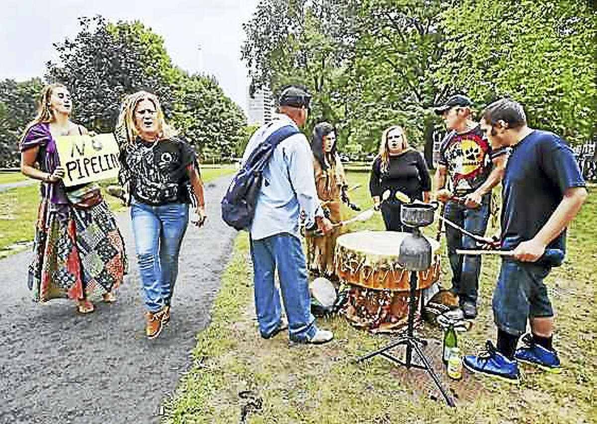 From left, Maggie Stovall of Stafford Springs and members of the Sacred Sorrow Singers — Maria Shining Dragonfly Wollen of Rhode Island; Angel Lion Heart; an unidentified woman; Jessica Animal Spirit Runner of Massachusetts; Joe Medicinehorse of Hartford; and Jessy Matthews of New Britain protest on the New Haven Green in a demonstration against the Dakota Access Pipeline.