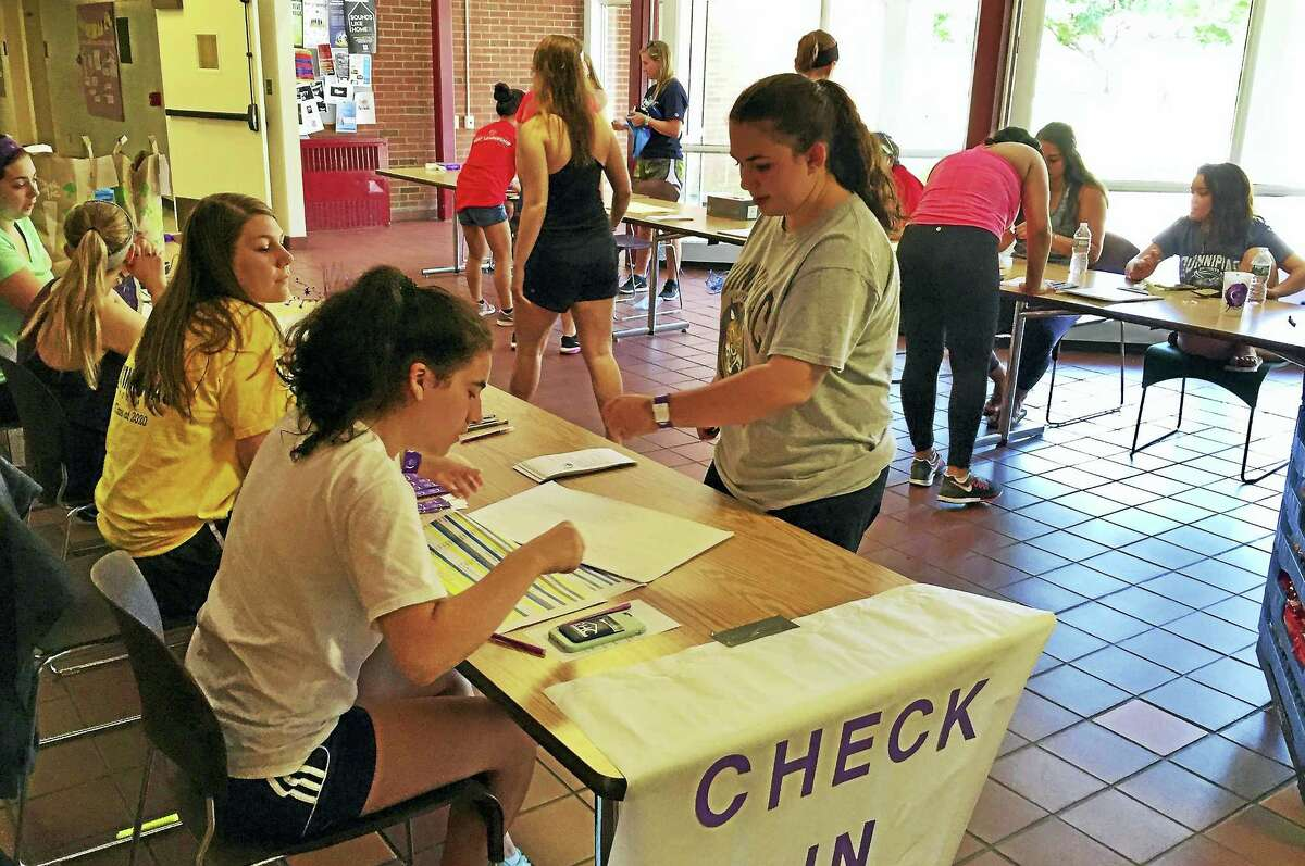 Students register for the Relay for Life event at Quinnipiac University on Saturday, Sept. 10, in Hamden.