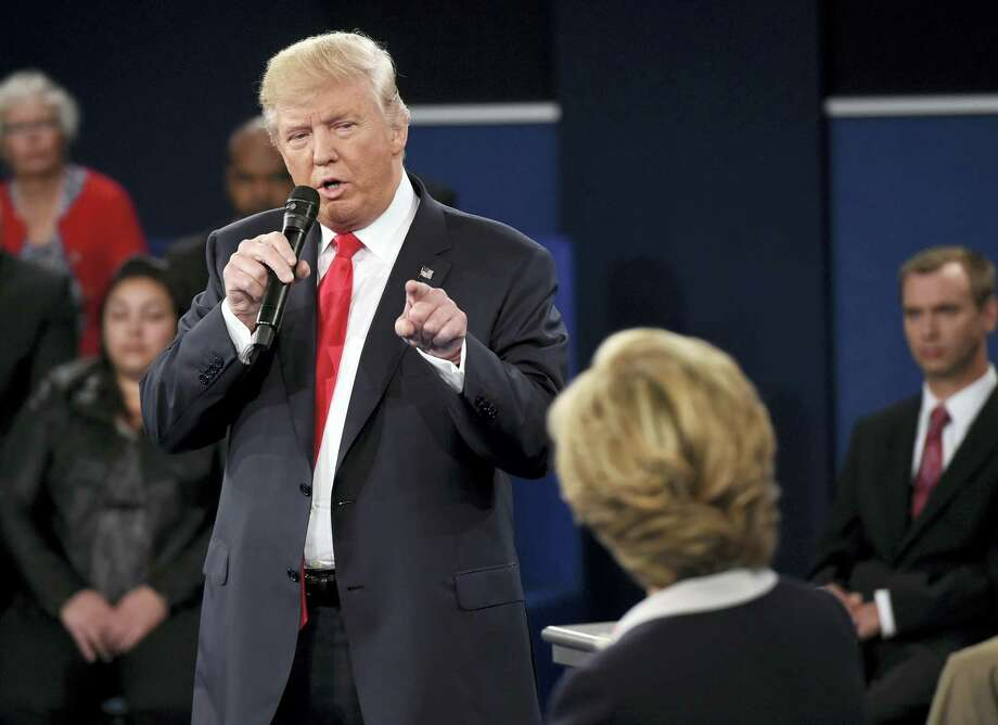 Republican presidential nominee Donald Trump points at Democratic presidential nominee Hillary Clinton as he speaks during the second presidential debate at Washington University in St. Louis Sunday. Photo: Saul Loeb — The Associated Press   / Copyright 2016 The Associated Press. All rights reserved.