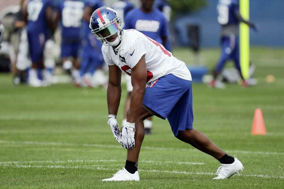 Giants wide receiver Victor Cruz is looking iffy for the Giants' preseason opener after sustaining a groin injury in practice on Tuesday. Photo: Julio Cortez — The Associated Press   / AP