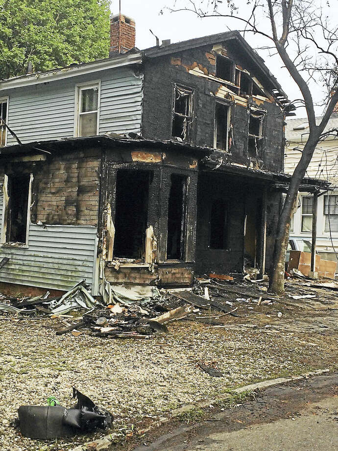 Fire destroyed a home at 16 Franklin St. in Ansonia Friday. Photo: Jean Falbo-Sosnovich — New Haven Register