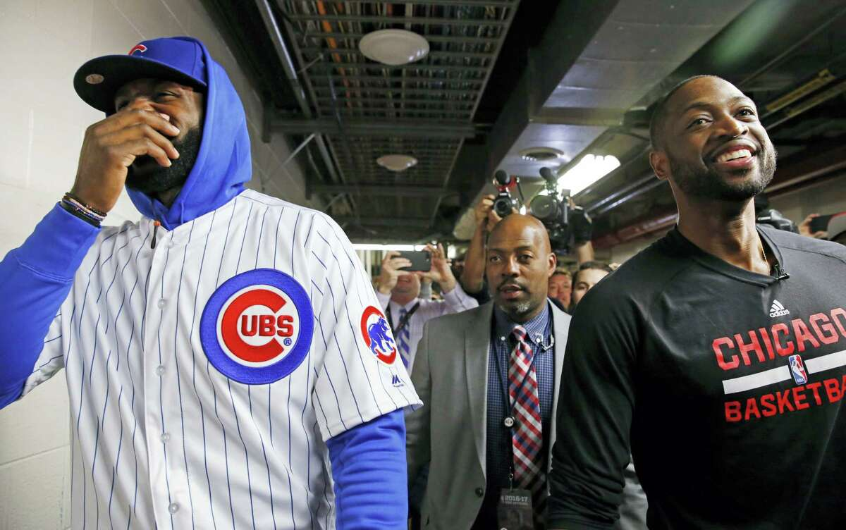 LeBron James, left, and Dwyane Wade smile as they walk on the hallway before a game on Friday in Chicago.