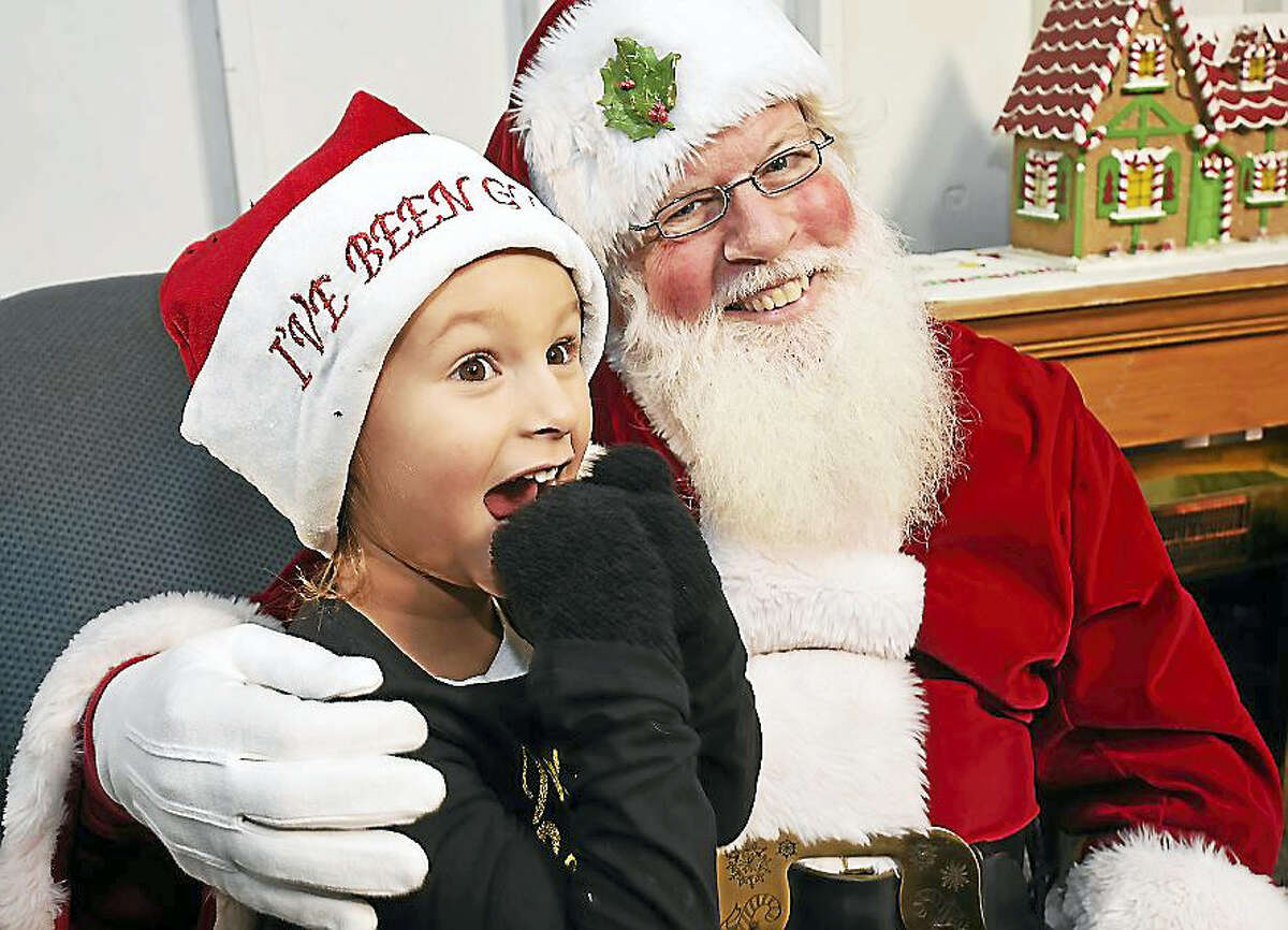 Isabella Chapman, 4, of New Haven was very excited to see Santa at the city's annual lighting of the Christmas Tree Thursday on the historic New Haven Green.
