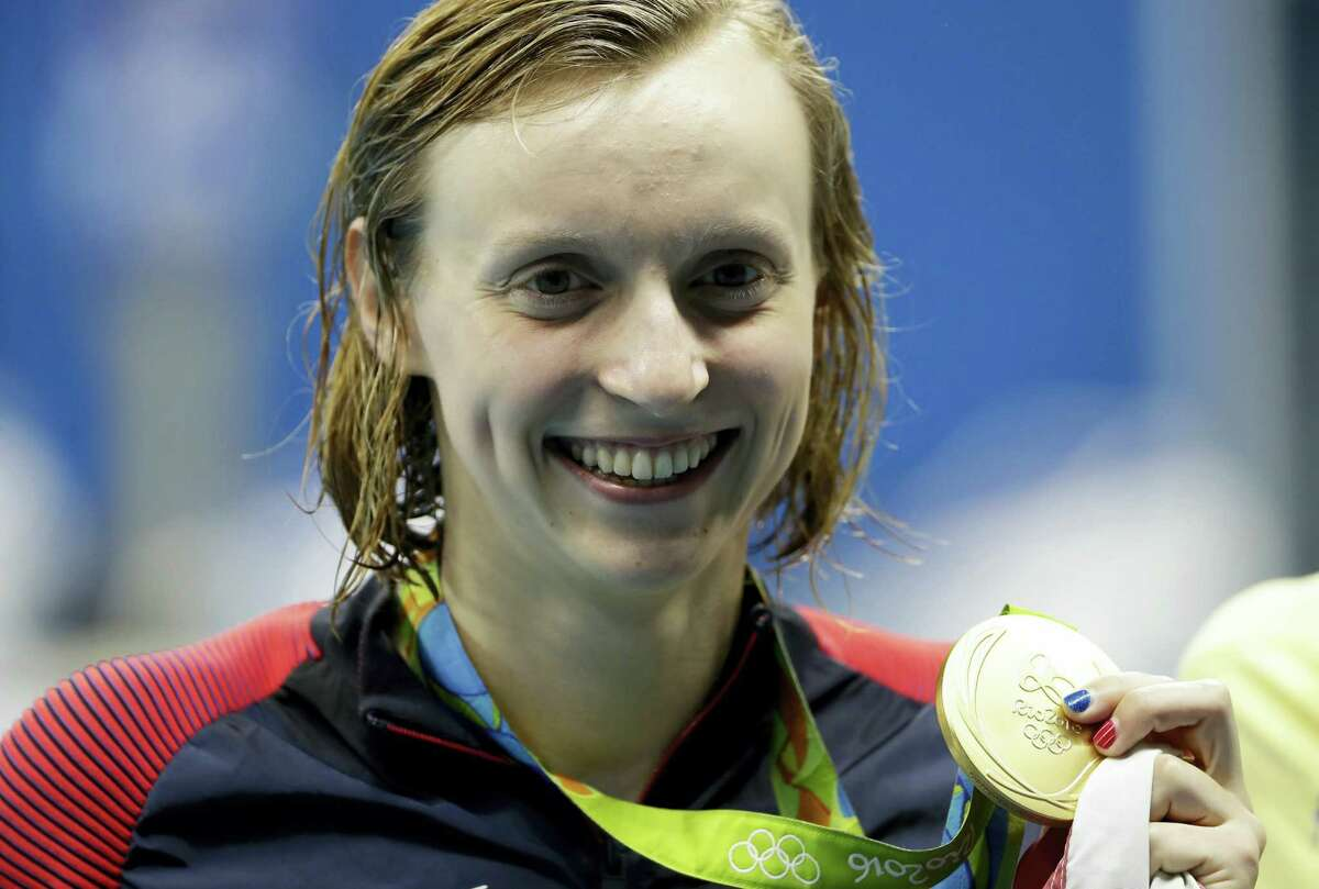 Katie Ledecky holds the gold medal after winning the women's 200-meter freestyle.