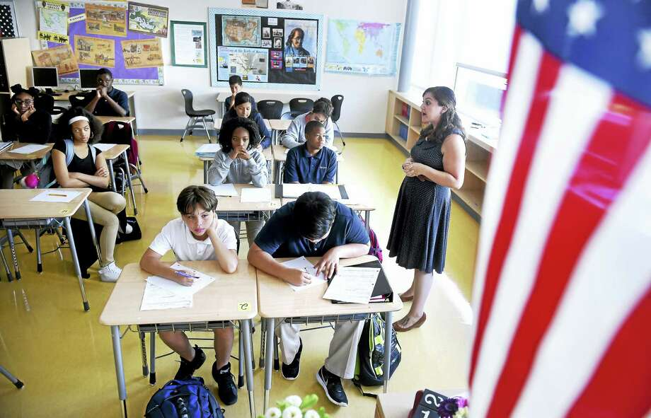 Laura Generoso, right, leads an eighth grade Social Studies class about the 9/11 attacks on the World Trade Center at East Rock Community Magnet School in New Haven. Photo: Arnold Gold — New Haven Register