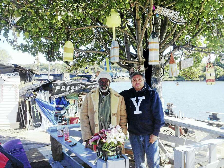 Curtis Libert and his friend Atroito Velez, longtime fishermen, at the site where Libert has set up comfortable chairs and keeps the area and waterfront clean and inviting to visitors at Poplar Street. Photo: MARY E. O'LEARY — NEW HAVEN REGISTER