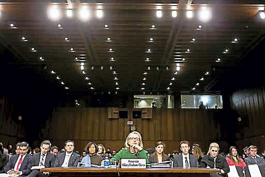 In this Wednesday, Jan. 23, 2013, file photo, Secretary of State Hillary Clinton testifies on Capitol Hill in Washington before the Senate Foreign Relations Committee hearing on the deadly September attack on the U.S. diplomatic mission in Benghazi, Libya, that killed Ambassador Chris Stevens and three other Americans. Photo: AP Photo/J. Scott Applewhite    / Copyright 2016 The Associated Press. All rights reserved. This material may not be published, broadcast, rewritten or redistribu